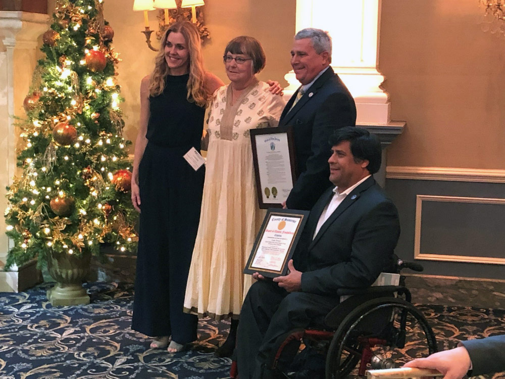Pictured left to right, at the awards luncheon: Catherine Ricker, Chair, Board of Directors, Somerset County Business Partnership; Linda Dousis, Owner, Administrative Services & Consulting, LLC; New Jersey Senator Christopher 'Kip' Bateman; Patrick Scaglione, Director, Somerset County Board of Chosen Freeholders.