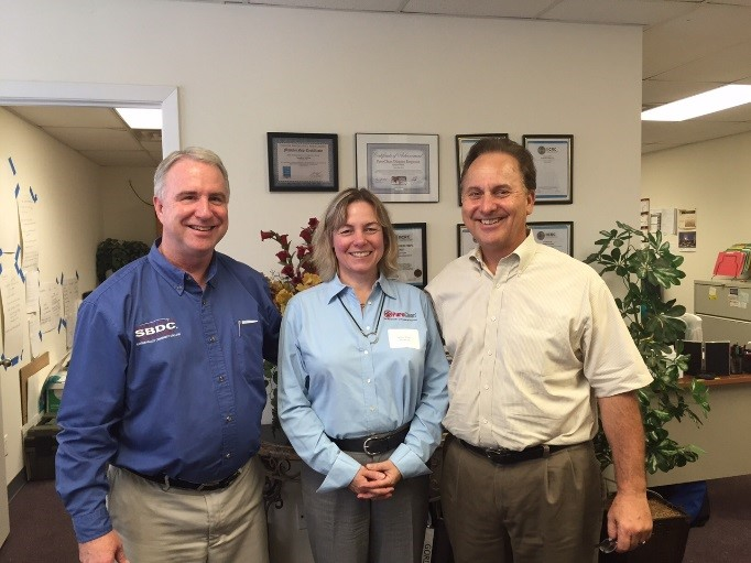 Pictured L to R; Bill Harnden, SBDC Regional Director, Sandra White, President & Rick Sobczak, Vice Pres., Sales