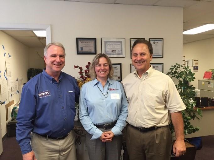 Pictured L to R; Bill Harnden, SBDC Regional Director, Sandra White, President & Rick Sobczak, Vice Pres., Sales